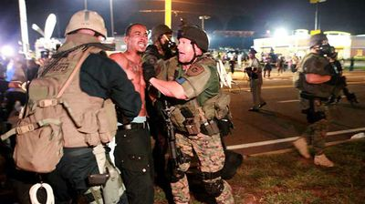 The National Guard detains a protester during a demonstration on Monday. (AP)