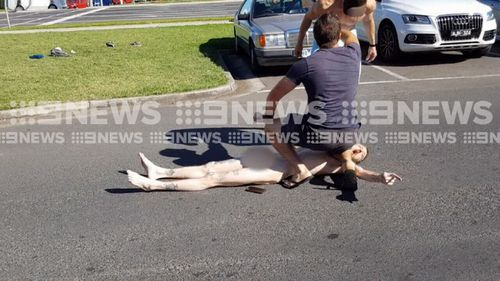 The off-duty officer held down the 34-year-old offender until police arrived. (9NEWS)