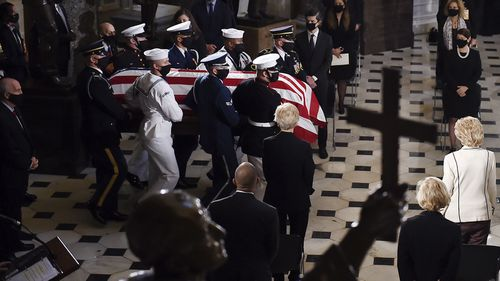 A joint services military honour guard carries the flag-draped casket of Justice Ruth Bader Ginsburg to lie in state in Statuary Hall of the US Capitol, Friday, Sept. 25, 2020 in Washington.