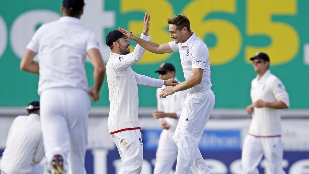 England players celebrate a Sri Lankan wicket. (AAP)