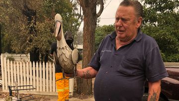 Dave McFarlane broke down in tears as he told of how he lost his Mallacoota holiday home  - a house he had built with his own hands - of over 30 years.