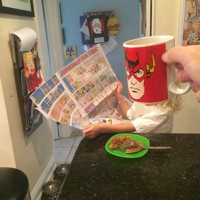 The Flash speed-reads some comics over waffles. (Instagram)