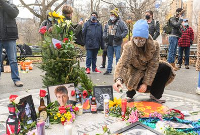 A person places a memorial candle for John Lennon on the 40th anniversary of his death at Strawberry Fields in Central Park on December 08, 2020 in New York City.
