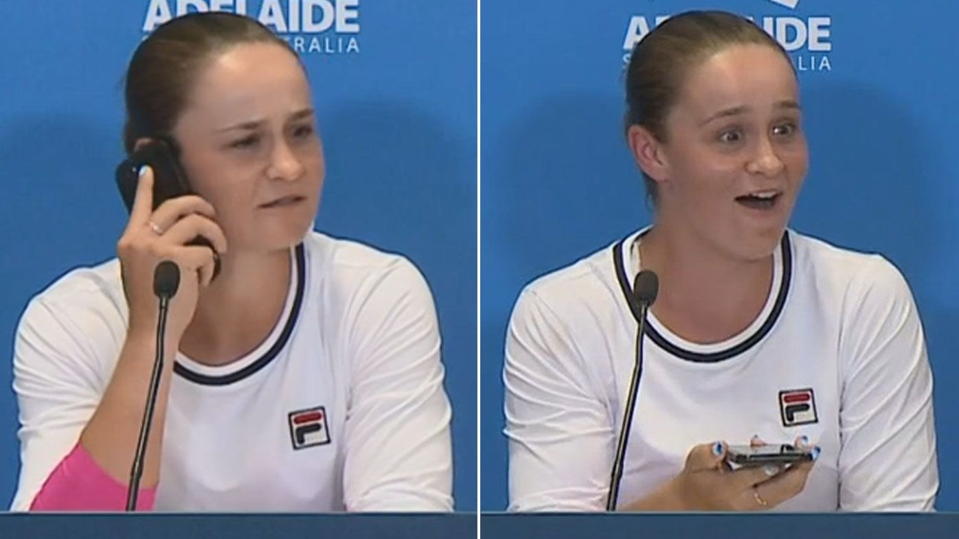 Ash Barty answered a reporter's phone during a press conference