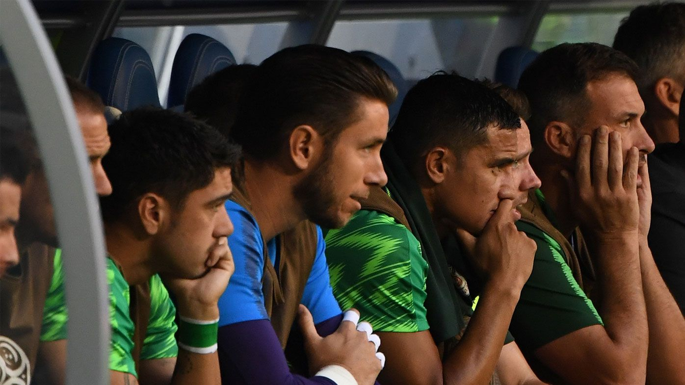 Tim Cahill watches the Socceroos play Denmark from the bench.