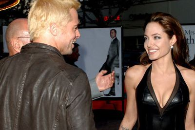 So sprung! Although the stealth couple didn't pose for pics together at the LA premiere of <i>Mr and Mrs Smith</i>, they were snapped swapping super-cute smiles at eachother on the red carpet. <br/><br/>Looks like Ange's leather LBD totally charmed buff Brad... <br/><br/>Source: Getty