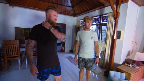 Aaron and Ben Richardson stand in the villa where their father's body was found.