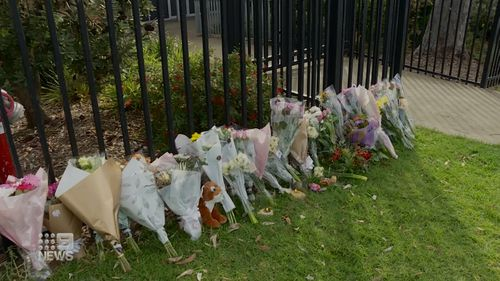 Floral tributes outside the school.