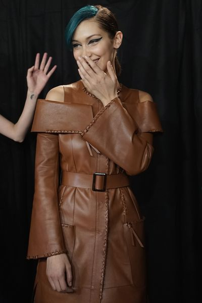 Bella Hadid wearing leather and a grin.