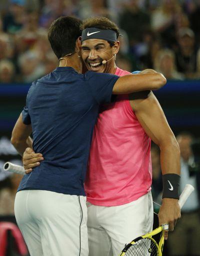 A hug between champions
