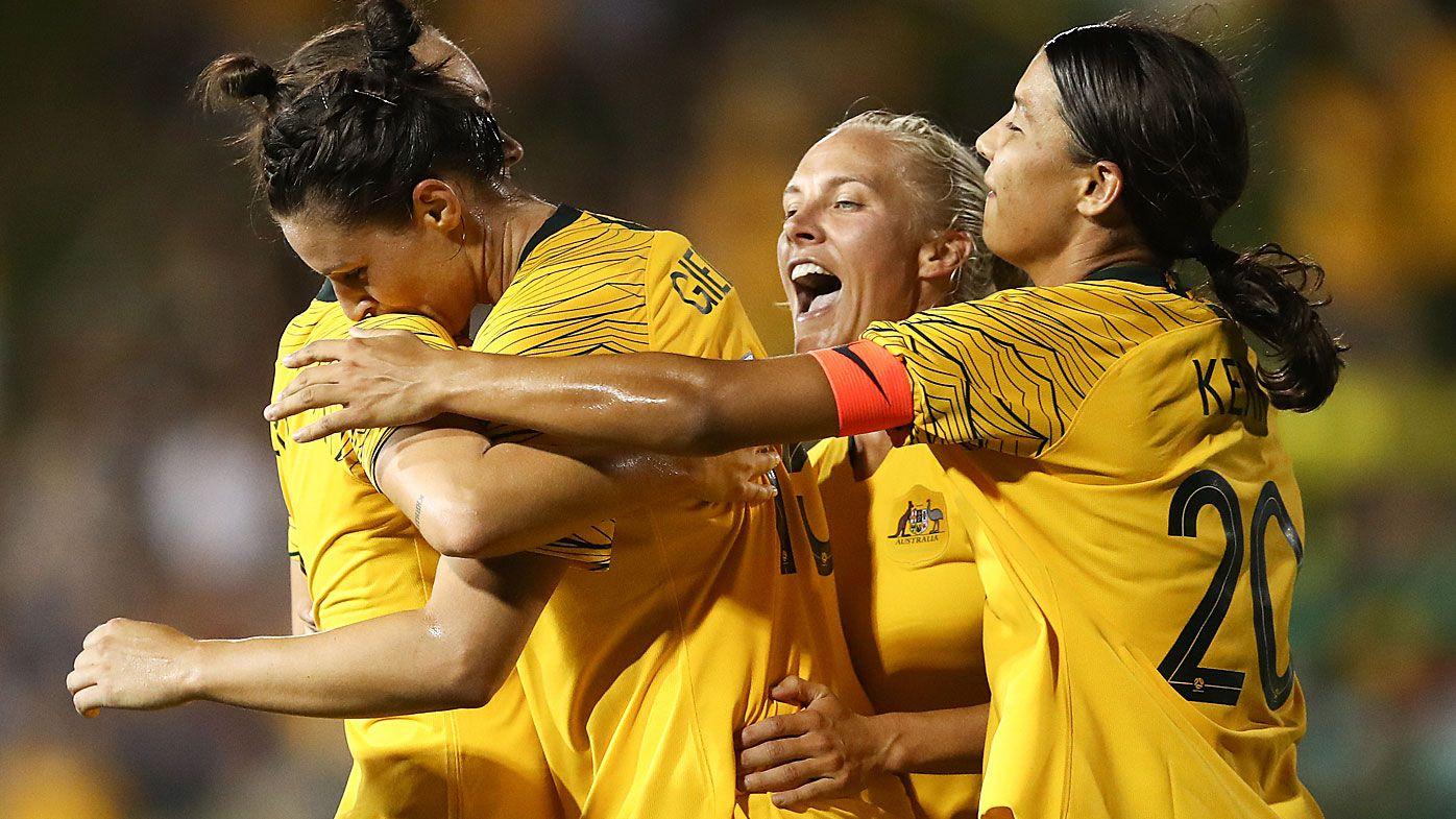 Gielnik celebrates her goal