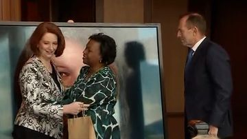 Julia Gillard leaves Tony Abbott waiting following the unveiling of her official portrait.