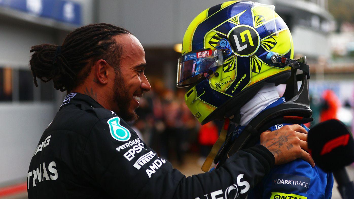Lando Norris congratulates Lewis Hamilton after the Mercedes driver won the Russian Grand Prix.