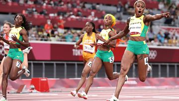 Jamaican star Elaine Thompson-Herah clinched back-to-back Olympic gold medals in the women's 100m over her compatriots.