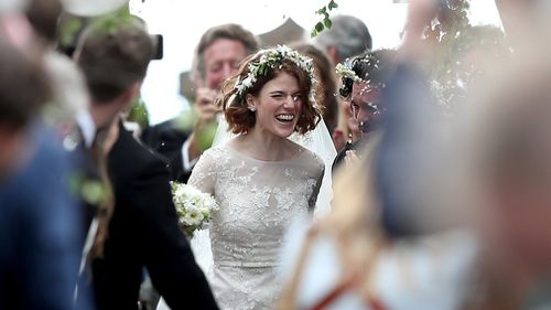Later the newlyweds were showered with rose petal confetti as they left the church and drove off. Picture: PA