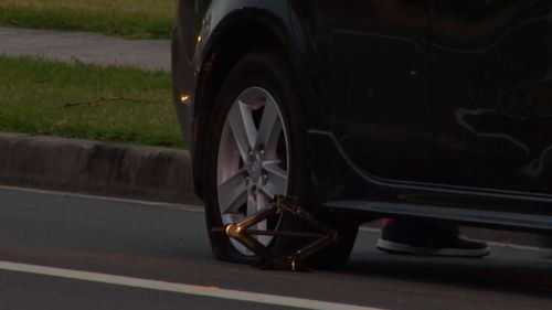 The 23-year-old man was struck when he was changing a tyre. (9NEWS)