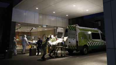 A resident of Epping Gardens Aged Care Facility is taken away in a ambulance in Melbourne, Australia.