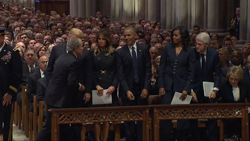 George W. Bush welcomed the Obamas to his father's memorial in Washington DC.