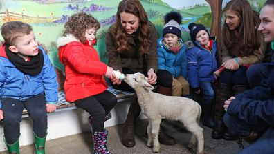 Kate Middleton, Duchess of Cambridge helps feed a Lamb with children from two local nurseries during a visit to The Ark Open Farm on February 12, 2020 in Newtownards, Northern Ireland.