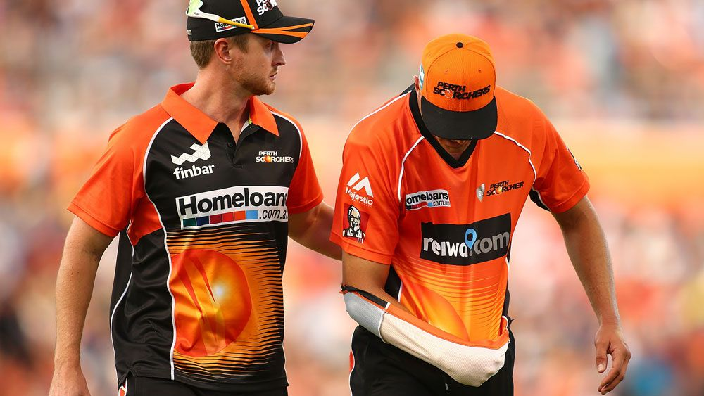 Perth paceman Nathan Coulter-Nile leaves the ground after dislocating his shoulder. (Getty)