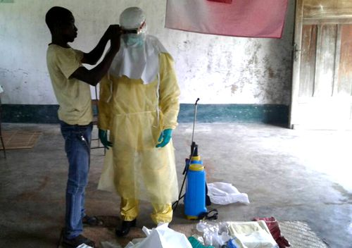 Health workers in protective clothing in Bikoro, the epicenter of the latest Ebola outbreak, in The Democratic Republic Of The Congo (AAP).