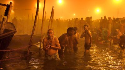 January 13, 2015: Hindu devotees taking holy dip on the auspicious occasion of Makar Sankranti during the annual Magh Mela gathering at the bank of Sangam in Allahabad, India. <br><br> Magh Mela is a 45-day annual Hindu religious fair held on the banks of Sangam, the confluence of three rivers Ganga, Yamuna and Saraswati.<br><br> Photo by Getty Images.