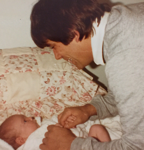 Boyle as a baby with her father.