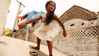 Kamali, 7, is the only girl skateboarder in her village.