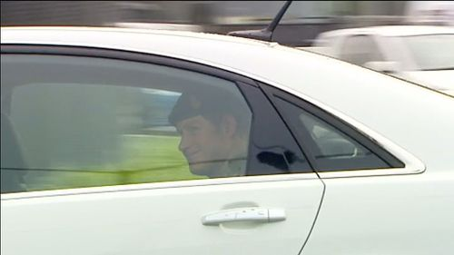 Harry is driven across the tarmac at Sydney Airport. (9NEWS)