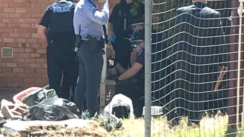 Police at the scene of the assault at Christies Beach.
