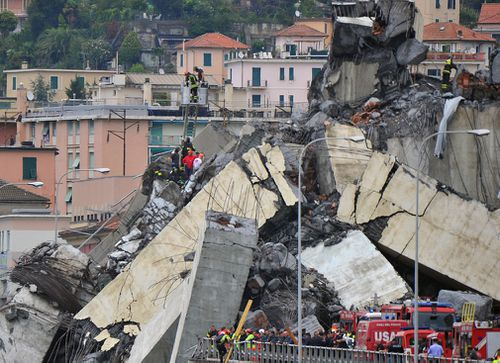 Rescuers search for survivors after the collapse of the highway motorway bridge in Genoa.