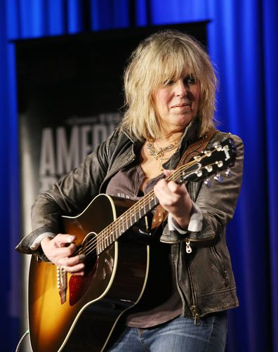 Lucinda Williams speaks/performs onstage during the GRAMMY Museum presents The Drop: Lucinda Williams at The GRAMMY Museum on October 13, 2014 in Los Angeles, California.