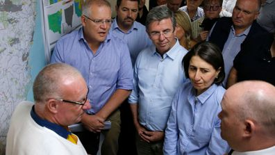 Prime Minister Scott Morrison and NSW Premier Gladys Berejiklian are briefed on the fires at Mid North Coast Fire Control Centre in Wauchope, NSW