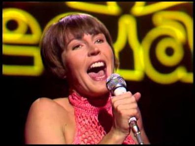Helen Reddy singing I Am Woman.
