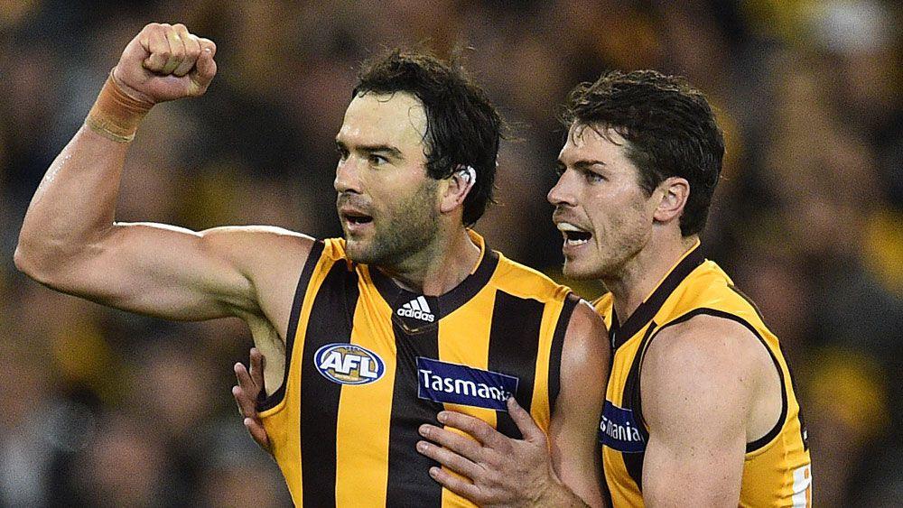 Undermanned Hawks belt Tigers in AFL