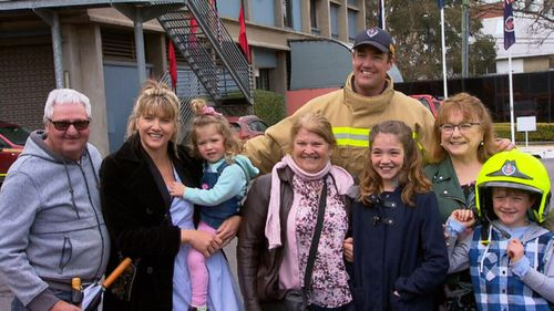 Former rugby player Trent Waterhouse celebrated completing his training with his family.