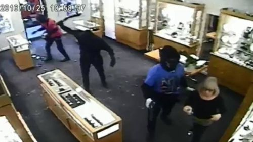 One offender is shown wielding a what appears to be a hammer. (9NEWS)