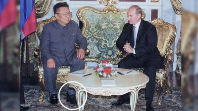 "<p><b>Kim Jong Il: Towering Leader</b></p>Kim Jong Il, who measured 160 cm (5' 3"") is pictured wearing platform shoes while meeting Vladimir Putin, who is 10cm taller. (Supplied)"