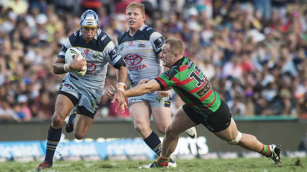 Johnathan Thurston breaks through Souths defensive line (AAP)
