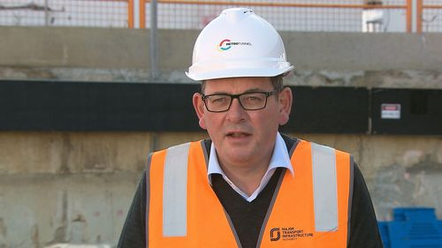 Victoria Premier Daniel Andrews has returned to work after sustaining a horror back injury.