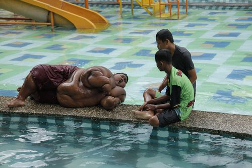 Arya Permana at a waterpark in Karawang, West Java, Indonesia, March 2017 (Channel 5 / Barcroft Productions / Barcroft Media via Getty Images)