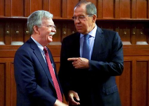 US National Security Adviser John Bolton, left, and Russian Foreign Minister Sergei Lavrov in Moscow.