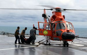 Indonesian divers find AirAsia bodies still strapped into seats