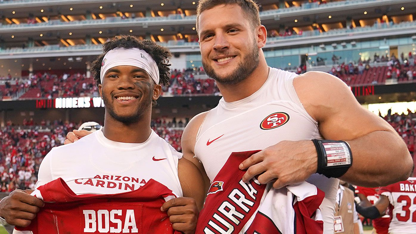 Kyler Murray #1 of the Arizona Cardinals and Nick Bosa #97 of the San Francisco 49ers exchange jersey after their NFL football game