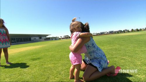 Seven-year-old Ella saved her little sister Emily from a dog attack.