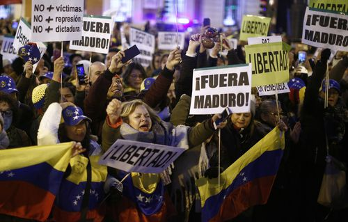 People in Spain protest against Venezuela's Nicolas Maduro and in support of an opposition leader self-proclaimed as the interim president of the country.