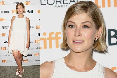 Pregnant Rosamund Pike glows at the <i>Hector and the Search for Happiness</i> premiere.