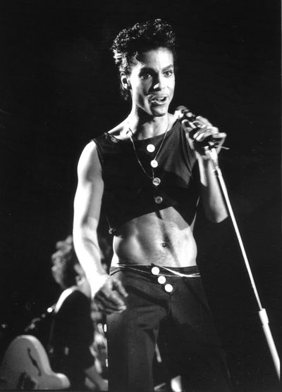 Prince's showcases his svelte physique - the result of a frenetic stage show and a vegan diet - in a crop top circa 1986.