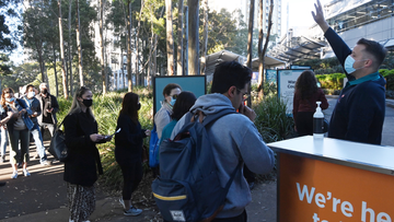People line up at Sydney Olympic Park's mass vaccination hub.