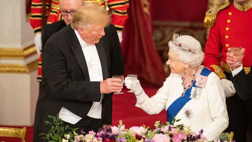 Donald Trump and the Queen toast each other at the royal banquet.